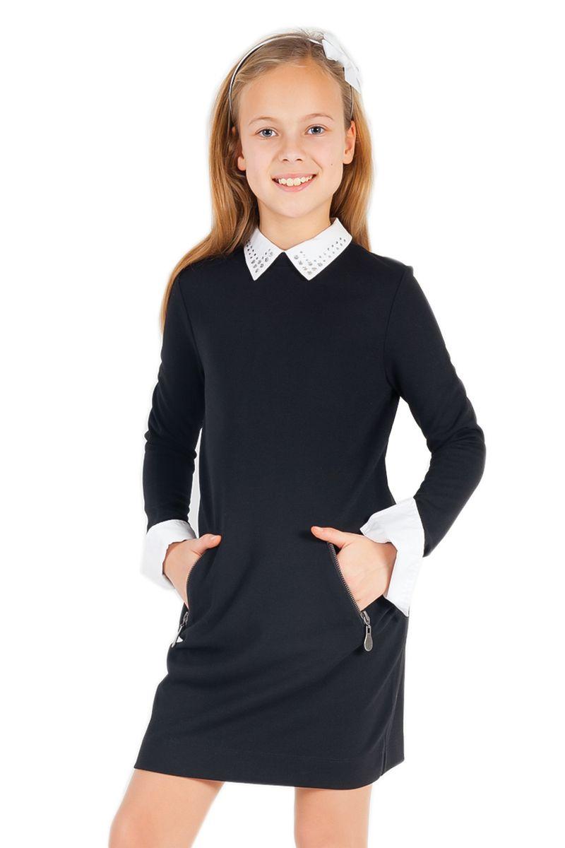 Платье для девочки. 21502GSC50021502GSC5005Очаровательное платье для девочки Gulliver идеально подойдет вашей малышке. Платье выполнено из эластичной вискозы с добавлением нейлона, оно необычайно мягкое, не сковывает движения малышки, великолепно отводит влагу от тела и не раздражает даже самую нежную и чувствительную кожу ребенка, обеспечивая наибольший комфорт. Платье-миди с длинными рукавами и отложным воротником застегивается на застежку-молнию и пуговицу на спинке. Спереди расположены два втачных кармана на застежках-молниях. Рукава дополнены контрастными манжетами на пуговицах. Украшенный стразами воротник пришит ручными стежками и при необходимости легко отпарывается и заменяется. Оригинальный современный дизайн и модная расцветка делают это платье практичным и стильным предметом школьного гардероба. В нем ваша малышка будет чувствовать себя уютно и комфортно и всегда будет в центре внимания!