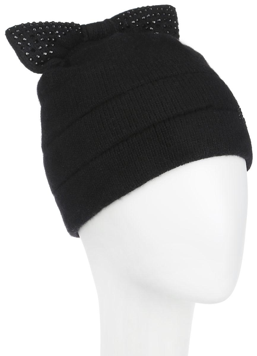 Шапка женская. 398398Оригинальная женская шапка Flioraj дополнит ваш наряд и не позволит вам замерзнуть в холодное время года. Шапка выполнена из высококачественной комбинированной пряжи из шерсти и акрила, что позволяет ей великолепно сохранять тепло и обеспечивает высокую эластичность и удобство посадки. Шапка оформлена мелкими стразами и дополнена небольшим вязаным бантом сверху. Такая шапка станет модным и стильным дополнением вашего зимнего гардероба, великолепно подойдет для городских прогулок, а также активного отдыха и занятия спортом. Она согреет вас и позволит подчеркнуть свою индивидуальность! Уважаемые клиенты! Обращаем ваше внимание на тот факт, что размер, доступный для заказа, является обхватом головы.