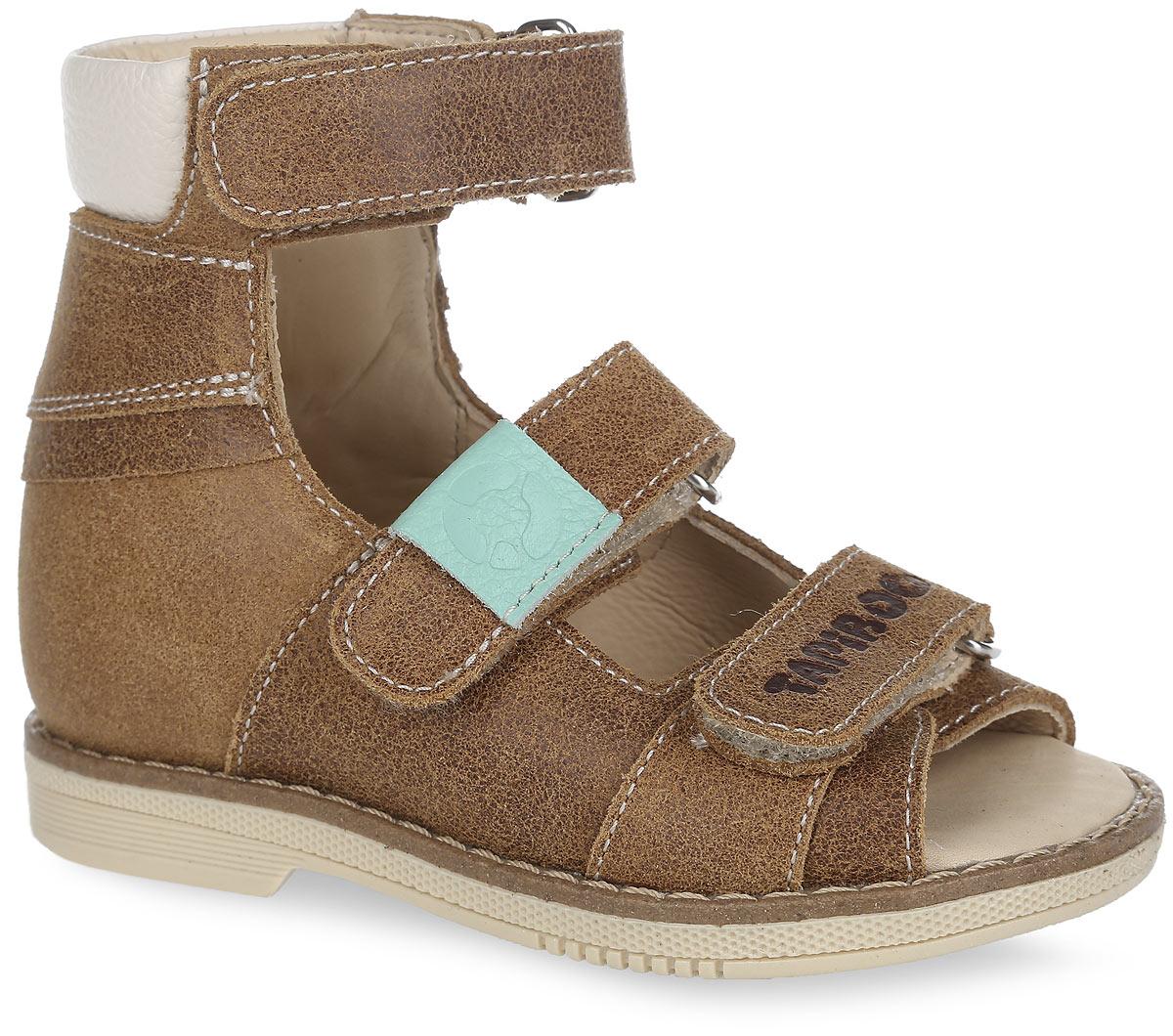 FT-26005.16-OL36O.01Стильные сандалии от TapiBoo придутся по душе вашему ребенку. Модель выполнена из натуральной кожи разной фактуры и оформлена на нижнем ремешке фирменным тиснением, на верхнем - разными по цвету шильдами с логотипом, для того чтобы ребенок знакомился с цветами и мог идентифицировать правую и левую ножку. Подкладка и стелька, изготовленные из натуральной кожи, гарантируют комфорт при ходьбе. Отсутствие швов на подкладке обеспечивает дополнительный комфорт и предотвращает натирание. Ремешки на застежках-липучках позволяют легко снимать и надевать обувь даже самым маленьким детям, обеспечивая при этом оптимальную фиксацию стопы. Жесткий фиксирующий задник надежно стабилизирует голеностопный сустав во время ходьбы, препятствуя развитию патологических изменений стопы. Широкий, устойчивый каблук специальной конфигурации каблук Томаса продлен с внутренней стороны до середины стопы, чтобы исключить вращение (заваливание) стопы вовнутрь. Упругая,...