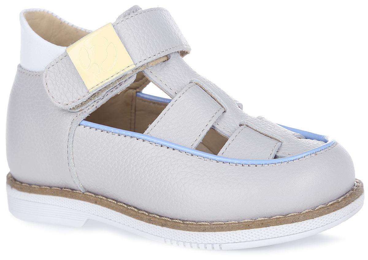 Туфли для мальчика. FT-25002.16-OL12S.01FT-25002.16-OL12S.01Стильные туфли от TapiBoo придутся по душе вашему юному моднику. Модель выполнена из натуральной кожи с зернистой фактурой и оформлена по канту контрастной вставкой. Область подъема дополнена отверстиями для лучшего воздухообмена и контрастной окантовкой, верхний ремешок - шильдой с логотипом бренда, подошва сзади - фирменным тиснением. Подкладка и стелька, изготовленные из натуральной кожи, гарантируют комфорт при ходьбе. Отсутствие швов на подкладке обеспечивает дополнительный комфорт и предотвращает натирание. Многослойная, анатомическая стелька дополнена сводоподдерживающим элементом для правильного формирования стопы. Ремешок на застежке-липучке позволяет легко снимать и надевать обувь даже самым маленьким детям, обеспечивая при этом оптимальную фиксацию стопы. Жесткий фиксирующий задник надежно стабилизирует голеностопный сустав во время ходьбы, препятствуя развитию патологических изменений стопы. Широкий, устойчивый каблук специальной конфигурации...