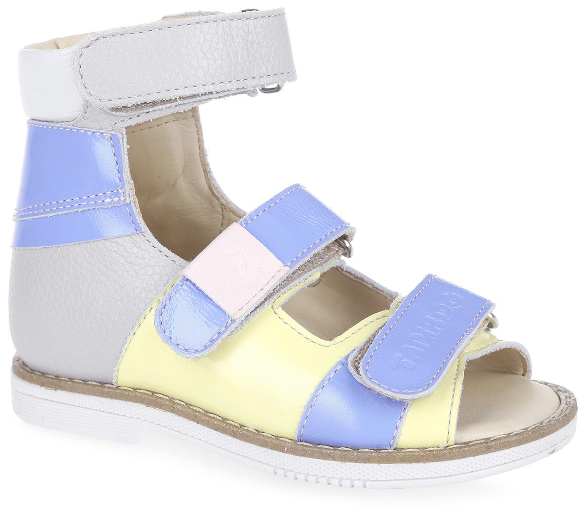 FT-26005.16-OL12S.01Стильные сандалии от TapiBoo заинтересуют вашу маленькую модницу. Модель выполнена из натуральной кожи разной фактуры и оформлена на нижнем ремешке фирменным тиснением, на ремешке в области подъема - шильдой с логотипом бренда, на подошве сзади - фирменным тиснением. Подкладка и стелька, изготовленные из натуральной кожи, гарантируют комфорт при ходьбе. Отсутствие швов на подкладке обеспечивает дополнительный комфорт и предотвращает натирание. Ремешки на застежках-липучках позволяют легко снимать и надевать обувь даже самым маленьким детям, обеспечивая при этом оптимальную фиксацию стопы. Жесткий фиксирующий задник надежно стабилизирует голеностопный сустав во время ходьбы, препятствуя развитию патологических изменений стопы. Широкий, устойчивый каблук специальной конфигурации каблук Томаса продлен с внутренней стороны до середины стопы, чтобы исключить вращение (заваливание) стопы вовнутрь. Упругая, умеренно-эластичная подошва имеет перекат,...