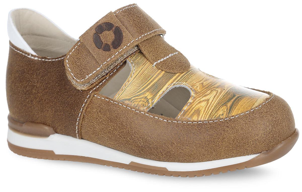 Туфли детские. FT-25003.16-OL36O.01FT-25003.16-OL36O.01Стильные туфли от TapiBoo придутся по душе вашему ребенку. Модель выполнена из натуральной кожи разной фактуры и оформлена в области подъема принтом, стилизованным под дерево, резными отверстиями для лучшего воздухообмена, на ремешке - шильдой с логотипом, по канту - контрастной вставкой из кожи. Подкладка и стелька, изготовленные из натуральной кожи, гарантируют комфорт при ходьбе. Подкладка обладает мягкостью и природной способностью пропускать воздух для создания оптимального температурного режима и предотвращения натирания ножки. Многослойная, анатомическая стелька дополнена сводоподдерживающим элементом для правильного формирования стопы. Ремешок на застежке-липучке позволяет легко снимать и надевать обувь даже самым маленьким детям, обеспечивая при этом оптимальную фиксацию. Жесткий фиксирующий задник надежно стабилизирует голеностопный сустав во время ходьбы, препятствуя развитию патологических изменений стопы. Эластичный подносок надежно защищает...