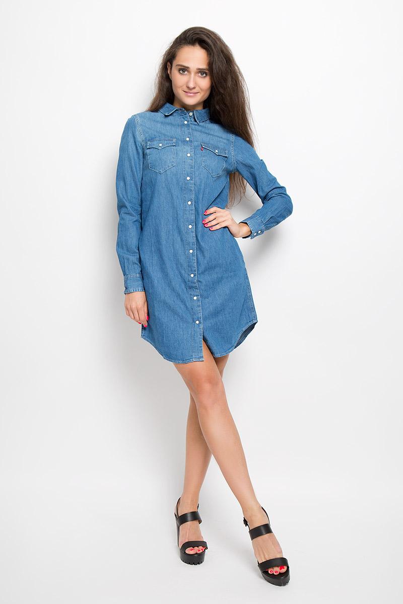 Платье. 192920001929200000Платье Levis®, выполненное по мотивам классической рубашки Western shirt, станет стильным дополнением к вашему гардеробу. Изготовленное из натурального хлопка, оно очень приятное на ощупь, не сковывает движений и позволяет коже дышать. Платье-рубашка с длинными рукавами и отложным воротником застегивается на кнопки и пуговицу. На манжетах предусмотрены застежки-кнопки. На груди расположены два накладных кармана с клапанами на кнопках, в боковых швах - два втачных кармана. Модель дополнена узким поясом в виде кожаного шнурка. Такое платье поможет создать яркий и привлекательный образ, в нем вам будет удобно и комфортно.