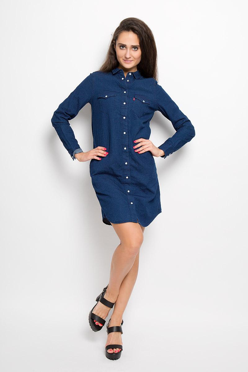 1929200020Платье Levis®, выполненное по мотивам классической рубашки Western shirt, станет стильным дополнением к вашему гардеробу. Изготовленное из натурального хлопка, оно очень приятное на ощупь, не сковывает движений и позволяет коже дышать. Платье-рубашка с длинными рукавами и отложным воротником застегивается на кнопки и пуговицу. На манжетах предусмотрены застежки-кнопки. На груди расположены два накладных кармана с клапанами на кнопках, в боковых швах - два втачных кармана. Модель дополнена узким поясом в виде текстильного шнурка. Такое платье поможет создать модный и привлекательный образ, в нем вам будет удобно и комфортно!