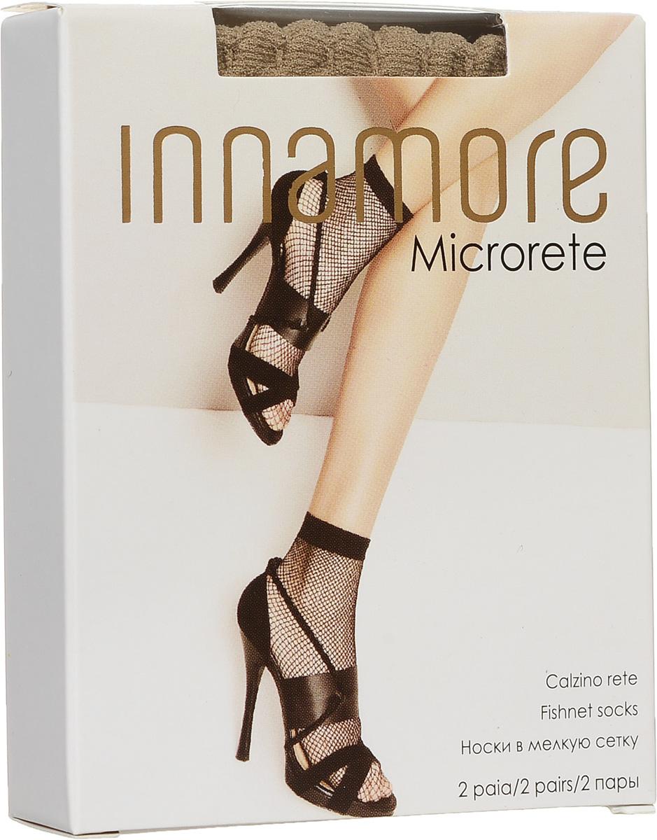 Носки женские Microrete 20, 2 пары. 78197819Удобные женские носки в мелкую сетку Innamore Microrete 20, изготовленные из высококачественного эластичного полиамида, идеально подойдут для повседневной носки. Входящий в состав материала полиамид обеспечивает износостойкость, а эластан позволяет носочкам легко тянуться, что делает их комфортными в носке. Эластичная резинка плотно облегает ногу, не сдавливая ее, обеспечивая комфорт и удобство и не препятствуя кровообращению. Практичные и комфортные носки великолепно подойдут к любой открытой обуви. В комплект входят 2 пары носков.