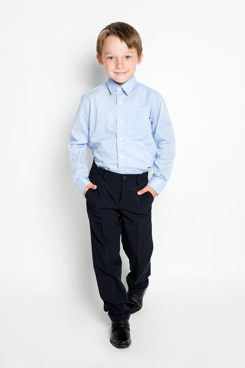 Рубашка для мальчика. SS-B-B-1402SS-B-B-1402-072Стильная рубашка для мальчика Silver Spoon идеально подойдет для школы. Изготовленная из полиэстера с хлопком, она необычайно мягкая, легкая и приятная на ощупь, не сковывает движения и позволяет коже дышать, не раздражает даже самую нежную и чувствительную кожу ребенка, обеспечивая ему наибольший комфорт. Рубашка с длинными рукавами и отложным воротничком застегивается на пуговицы. На груди предусмотрен накладной кармашек. Низ модели по бокам закруглен. Такая рубашка - незаменимая вещь для школьной формы, отлично сочетается с брюками, жилетами и пиджаками.