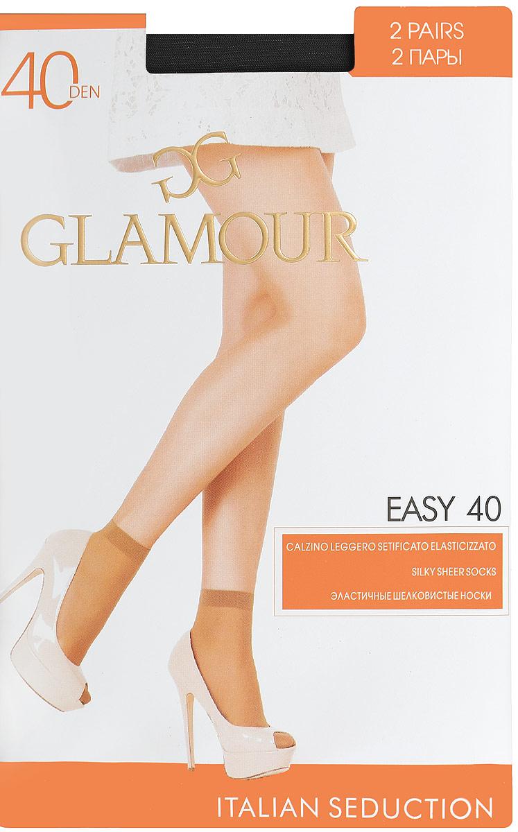 Носки женские Easy 40, 2 парыEasy 40Удобные женские носки Glamour Easy 40, изготовленные из высококачественного эластичного полиамида, идеально подойдут для повседневной носки. Входящий в состав материала полиамид обеспечивает износостойкость, а эластан позволяет носочкам легко тянуться, что делает их комфортными в носке. Эластичная резинка плотно облегает ногу, не сдавливая ее, обеспечивая комфорт и удобство и не препятствуя кровообращению. Практичные и комфортные носки с укрепленным прозрачным мыском великолепно подойдут к любой открытой обуви. В комплект входят 2 пары носков. Плотность: 40 den.