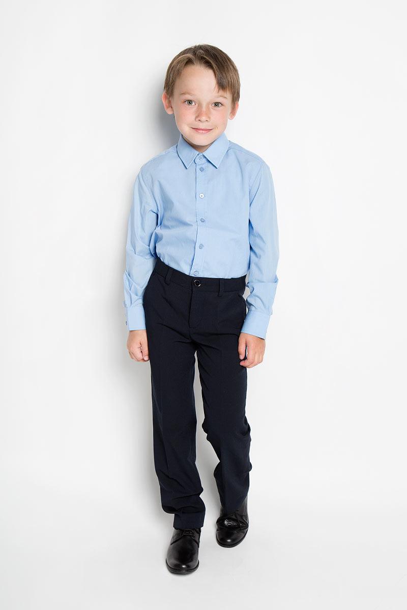 Рубашка для мальчика. 215BBBS2302/215BBBS2301215BBBS2301Стильная рубашка для мальчика Button Blue с длинными рукавами идеально подойдет вашему ребенку. Изготовленная из хлопка с добавлением полиэстера, она мягкая и приятная на ощупь, не сковывает движения и позволяет коже дышать, не раздражает даже самую нежную и чувствительную кожу ребенка, обеспечивая ему наибольший комфорт. Рубашка классического кроя с отложным воротничком застегивается на пуговицы. Рукава имеют широкие манжеты, также застегивающиеся на пуговицы. Понизу модель дополнена небольшими боковыми закруглениями. Современный дизайн и расцветка делают эту рубашку стильным предметом детского гардероба. Ее можно носить как с джинсами, так и с классическими брюками.