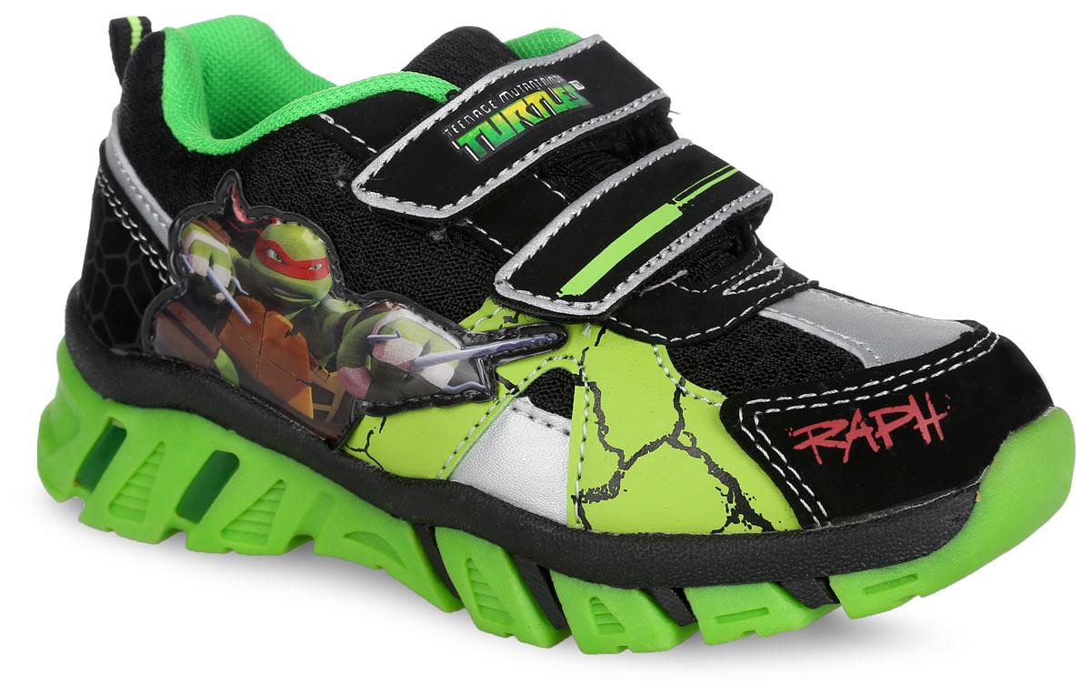 TU000508Стильные кроссовки Turtles от Mursu придутся по душе вашему мальчику. Модель, выполненная из искусственной кожи и текстиля, сбоку оформлена нашивкой из ПВХ с изображением героя мультфильма Черепашки-ниндзя, на мысе - надписью Raph. Ремешки с застежками-липучками обеспечат надежную фиксацию модели на ноге. Внутренняя поверхность из текстиля не натирает. Стелька из ЭВА материала с текстильной поверхностью гарантирует комфорт при движении. Подошва с рифлением обеспечивает идеальное сцепление с любой поверхностью. При ходьбе в подошве мигают огоньки. Оригинальные кроссовки - незаменимая вещь в гардеробе каждого мальчика!