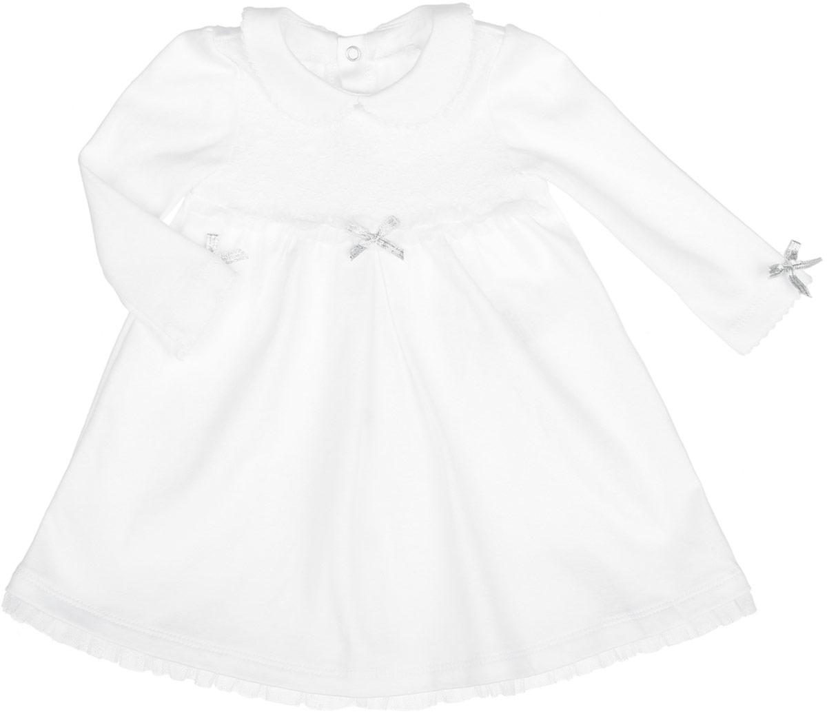 Платье для девочки. PL12PL12-1Нарядное платье для девочки БЕМБІ идеально подойдет вашей маленькой принцессе. Изготовлено платье из натурального хлопка, благодаря чему оно необычайно мягкое и приятное на ощупь, не сковывает движения малышки и позволяет коже дышать, не раздражает даже самую нежную и чувствительную кожу ребенка, обеспечивая ему наибольший комфорт. Платье с отложным воротником и длинными рукавами сзади застегиваются на кнопки. Модель дополнена кружевной вставкой на уровне груди. Изделие оформлено оборками из сетчатого, легкого материала и небольшими бантиками на груди и по низу рукавов. Оригинальный современный дизайн и модная расцветка делают это платье модным и стильным предметом детского гардероба. В нем ваша малышка будет чувствовать себя уютно и комфортно и всегда будет в центре внимания!