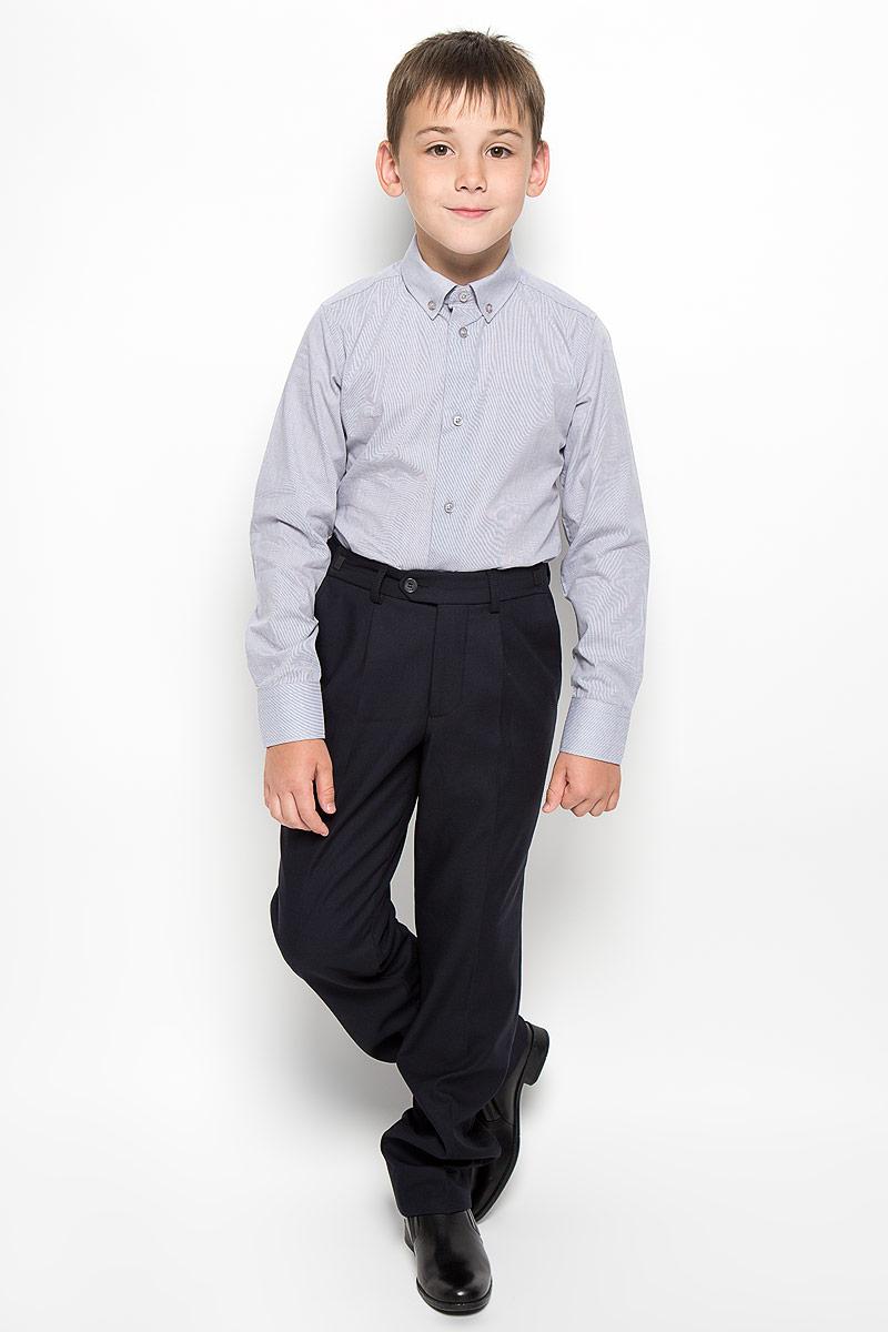 Рубашка64187_OLB, вар.1Стильная рубашка для мальчика Orby School с длинными рукавами идеально подойдет вашему ребенку. Изготовленная из полиэстера с добавлением хлопка, она мягкая и приятная на ощупь, не сковывает движения и позволяет коже дышать, не раздражает даже самую нежную и чувствительную кожу ребенка, обеспечивая ему наибольший комфорт. Рубашка классического кроя с отложным воротничком застегивается на пуговицы по всей длине. Рукава имеют широкие манжеты, также застегивающиеся на пуговицы. Низ изделия слегка закруглен. Оригинальный современный дизайн и модная расцветка делают эту рубашку стильным предметом детского гардероба. Ее можно носить как с джинсами, так и с классическими брюками.