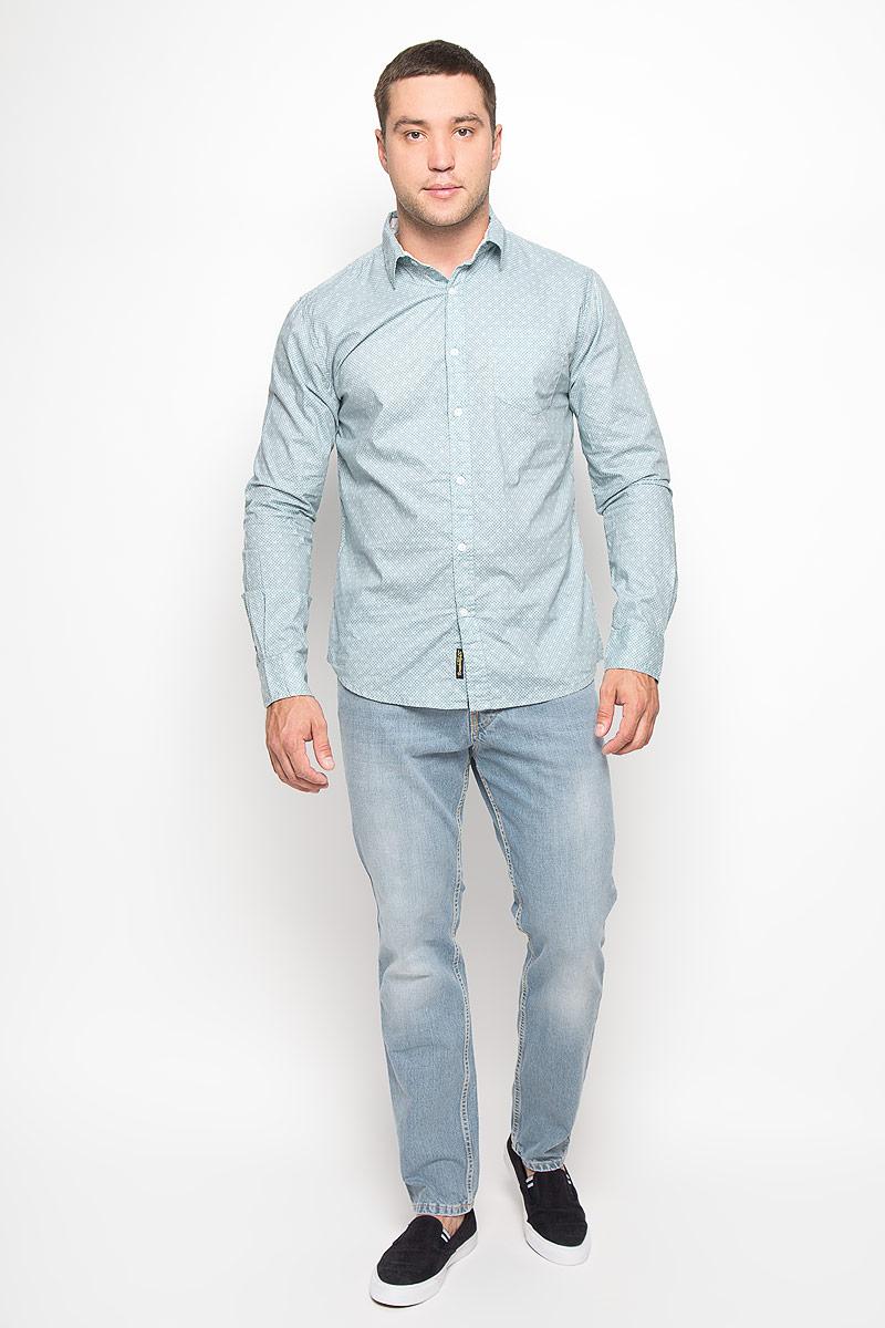 Рубашка мужская. 1015135410151354 Стильная мужская рубашка Broadway, изготовленная из натурального хлопка, необычайно мягкая и приятная на ощупь, не сковывает движения и позволяет коже дышать, обеспечивая наибольший комфорт. Модель с отложным воротником, длинными рукавами и полукруглым низом застегивается на пластиковые пуговицы. На груди изделия располагается небольшой накладной карман. Рукава рубашки дополнены манжетами на пуговицах. Модель оформлена принтом в мелкий квадратик. Эта рубашка идеальный вариант для повседневного гардероба. Такая модель порадует настоящих ценителей комфорта и практичности!
