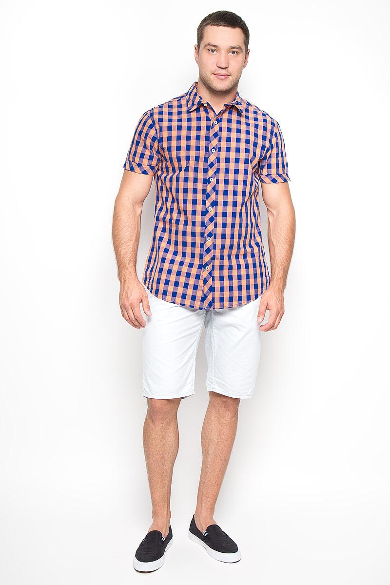 Рубашка мужская. 1015097310150973 390Стильная мужская рубашка Broadway, изготовленная из натурального хлопка, необычайно мягкая и приятная на ощупь, не сковывает движения и позволяет коже дышать, обеспечивая наибольший комфорт. Модель с отложным воротником, короткими рукавами и полукруглым низом застегивается на пластиковые пуговицы. Изделие оформлено ярким принтом в клетку. Эта рубашка идеальный вариант для повседневного гардероба. Такая модель порадует настоящих ценителей комфорта и практичности!