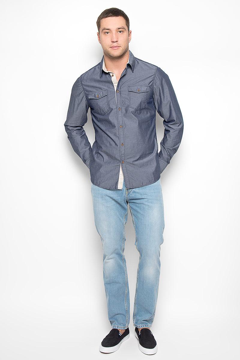 Рубашка мужская Nyc Academy. 1015077010150770 596Стильная мужская рубашка Nyc Academy, изготовленная из натурального хлопка, необычайно мягкая и приятная на ощупь, не сковывает движения и позволяет коже дышать, обеспечивая наибольший комфорт. Модель с отложным воротником, длинными рукавами и полукруглым низом застегивается на пластиковые пуговицы. На груди расположено два накладных кармана с клапанами на пуговицах. Низ рукавов дополнен манжетами на пуговицах. Эта рубашка идеальный вариант для повседневного гардероба. Такая модель порадует настоящих ценителей комфорта и практичности!