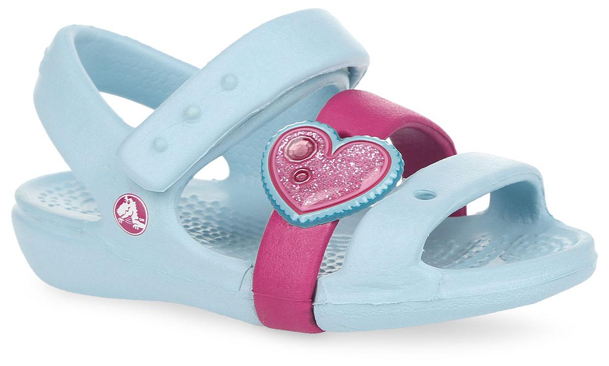 Сандалии для девочки Keeley Springtime. 202614202614-4Q6Прелестные сандалии Keeley Springtime от Crocs очаруют вашу девочку с первого взгляда! Модель выполнена из полимера Croslite. Благодаря материалу Croslite обувь невероятно легкая, мягкая и удобная. Материал Croslite - бактериостатичен, препятствует появлению неприятных запахов и легок в уходе: быстро сохнет и не оставляет следов на любых поверхностях. Один из передних ремешков оформлен отверстием для джибитса, другой - декоративным сердцем. Ремешок с застежкой-липучкой обеспечивает надежную фиксацию модели на ноге. Рельефная поверхность верхней части подошвы комфортна при движении. Рифленое основание подошвы гарантирует идеальное сцепление с любой поверхностью. Такие сандалии принесут комфорт и радость вашей моднице.