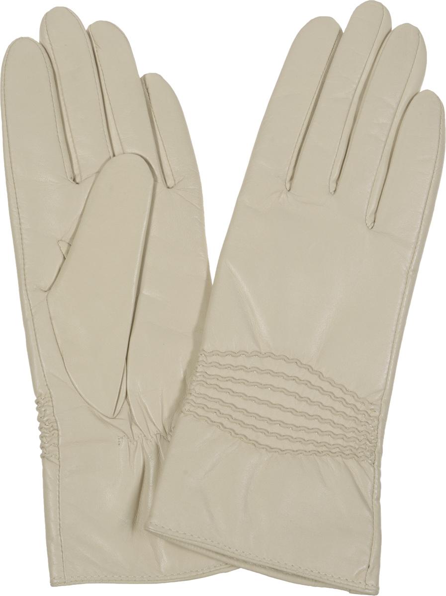 Перчатки9.3-1 blackЭлегантные женские перчатки Fabretti станут великолепным дополнением вашего образа и защитят ваши руки от холода и ветра во время прогулок. Перчатки выполнены из эфиопской перчаточной кожи ягненка на подкладке из шерсти с добавлением кашемира, что позволяет им надежно сохранять тепло. Манжеты с тыльной стороны присборены на эластичные резинки. Оформлено изделие оригинальной декоративной прострочкой. Такие перчатки будут оригинальным завершающим штрихом в создании современного модного образа, они подчеркнут ваш изысканный вкус и станут незаменимым и практичным аксессуаром.