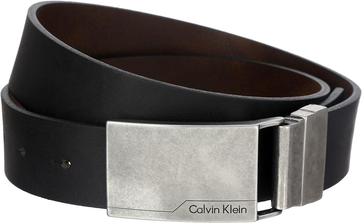РеменьK50K501833_0010Эффектный мужской ремень Сalvin Klein станет великолепным дополнением к любому образу. Широкий ремень выполнен из натуральной кожи. Прямоугольная пряжка с крючком выполнена из блестящего металла, она позволит вам легко и быстро зафиксировать ремень и отрегулировать его длину. Элегантный и строгий ремень превосходно сочетается с любыми нарядами. Этот стильный аксессуар прекрасно дополнит ваш образ и позволит вам подчеркнуть свой вкус и индивидуальность. Уважаемые клиенты! Обращаем ваше внимание на тот факт, что размер ремня, доступный для заказа, является его длиной.