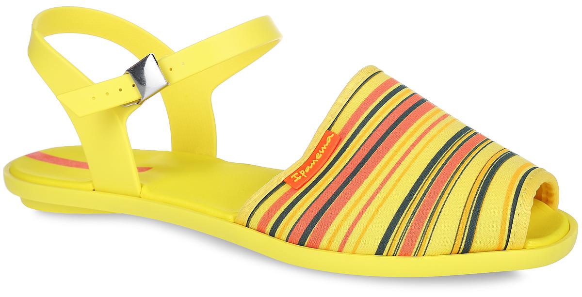 81841-90245Яркие сандалии Neoprint Sand Fem от Ipanema не оставят равнодушной настоящую модницу. Модель, изготовленная из текстиля и ПВХ (поливинилхлорида), оформлена принтом в полоску. Ремешки с металлической пряжкой надежно зафиксируют изделие на ноге. Мягкая стелька из материала EVA комфортна при движении. Рифление на подошве обеспечивает отличное сцепление с любой поверхностью. Удобные сандалии займут достойное место среди вашей летней обуви.