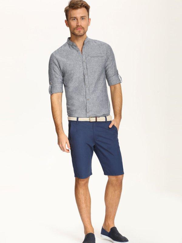 РубашкаSKL2014GRСтильная мужская рубашка, приталенного кроя, выполнена из хлопка и льня. Модель воротником-стойкой и длинными рукавами застегивается спереди на пуговицы. Спереди рубашка оформлена имитацией прорезного кармана. Рукава дополнены хлястиками, фиксирующимися на пуговицы, а также манжетами с пуговицами.