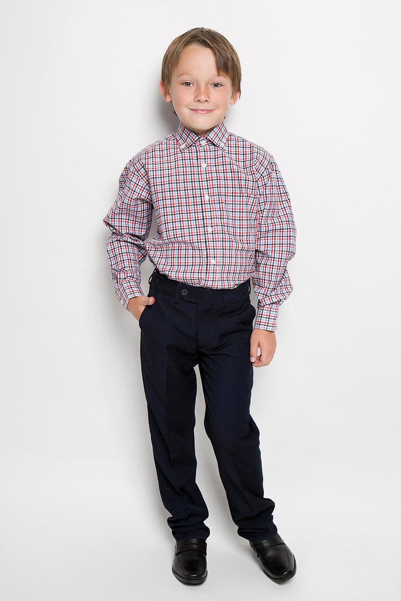 TR.102/ST/038/25Стильная рубашка для мальчика Imperator идеально подойдет вашему юному мужчине. Изготовленная из хлопка с добавлением полиэстера, она мягкая и приятная на ощупь, не сковывает движения и позволяет коже дышать, не раздражает даже самую нежную и чувствительную кожу ребенка, обеспечивая ему наибольший комфорт. Модель классического кроя с длинными рукавами и отложным воротничком застегивается по всей длине на пуговицы. Края воротника пристегиваются к рубашке с помощью пуговиц. На груди располагается накладной карман. Края рукавов дополнены широкими манжетами на пуговицах. Низ изделия немного закруглен к боковым швам. Оформлено изделие принтом в клетку. Такая рубашка будет прекрасно смотреться с брюками и джинсами. Она станет неотъемлемой частью детского гардероба.