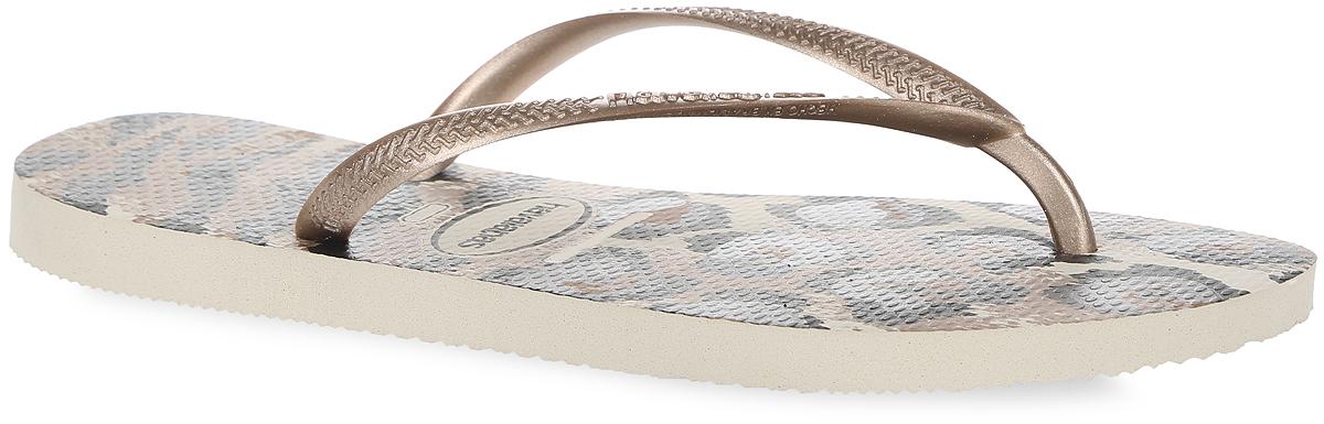 4103352-8430Модные женские сланцы Slim Animals от Havaianas придутся вам по душе. Верх модели, выполненный из резины, оформлен рельефным орнаментом и названием бренда. Ремешки с перемычкой гарантируют надежную фиксацию модели на ноге. Подошва выполнена из материала ЭВА. Верхняя поверхность подошвы оформлена леопардовым принтом. Рифление на верхней поверхности подошвы предотвращает выскальзывание ноги. Рельефное основание подошвы обеспечивает уверенное сцепление с любой поверхностью. Удобные сланцы прекрасно подойдут для похода в бассейн или на пляж.