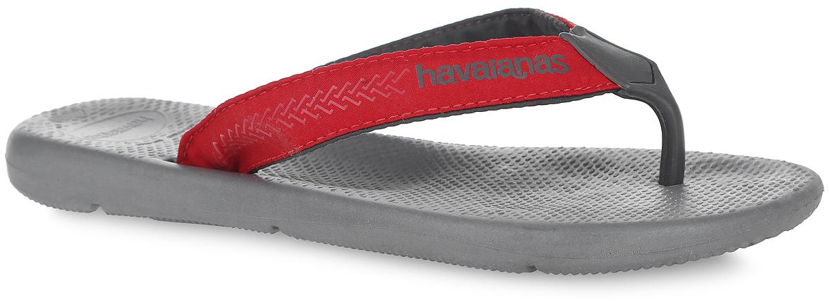 Сланцы мужские Surf Pro. 4133421-51784133421-5178Модные мужские сланцы Surf Pro от Havaianas придутся вам по душе. Верх модели, выполненный из резины и текстиля, оформлен оригинальным орнаментом и названием бренда. Ремешки с перемычкой гарантируют надежную фиксацию модели на ноге. Резиновая подошва комфортна при движении. Рифление на верхней поверхности подошвы предотвращает выскальзывание ноги. Рельефное основание подошвы обеспечивает уверенное сцепление с любой поверхностью. Удобные сланцы прекрасно подойдут для похода в бассейн или на пляж.