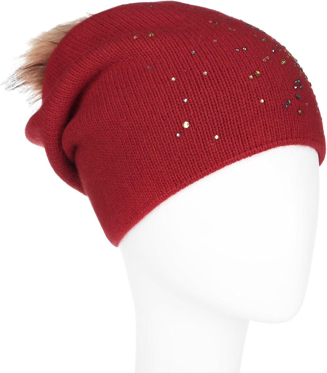 ШапкаA16-12130_317Стильная женская шапка Finn Flare дополнит ваш наряд и не позволит вам замерзнуть в холодное время года. Шапка выполнена из высококачественной пряжи, что позволяет ей великолепно сохранять тепло и обеспечивает высокую эластичность и удобство посадки. Изделие дополнено тёплой подкладкой. Модель оформлена пушистым помпоном из меха енота и украшена узором из страз. Такая шапка станет модным и стильным дополнением вашего гардероба. Она согреет вас и позволит подчеркнуть свою индивидуальность!