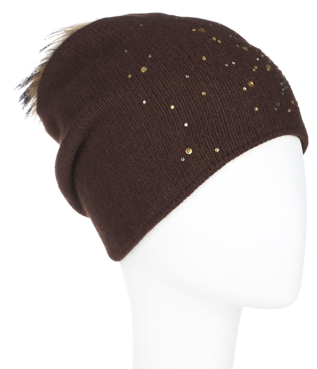 A16-12130_317Стильная женская шапка Finn Flare дополнит ваш наряд и не позволит вам замерзнуть в холодное время года. Шапка выполнена из высококачественной пряжи, что позволяет ей великолепно сохранять тепло и обеспечивает высокую эластичность и удобство посадки. Изделие дополнено тёплой подкладкой. Модель оформлена пушистым помпоном из меха енота и украшена узором из страз. Такая шапка станет модным и стильным дополнением вашего гардероба. Она согреет вас и позволит подчеркнуть свою индивидуальность!