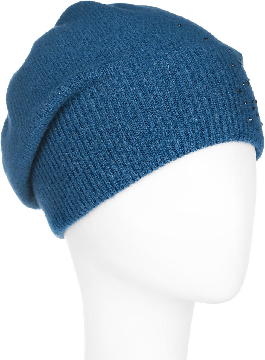 A16-32120_145Стильная женская шапка Finn Flare дополнит ваш наряд и не позволит вам замерзнуть в холодное время года. Шапка выполнена из высококачественной пряжи, что позволяет ей великолепно сохранять тепло и обеспечивает высокую эластичность и удобство посадки. Модель оформлена россыпью страз и металлической эмблемой с логотипом производителя. Понизу предусмотрена вязаная резинка. Такая шапка станет модным и стильным дополнением вашего гардероба. Она согреет вас и позволит подчеркнуть свою индивидуальность!
