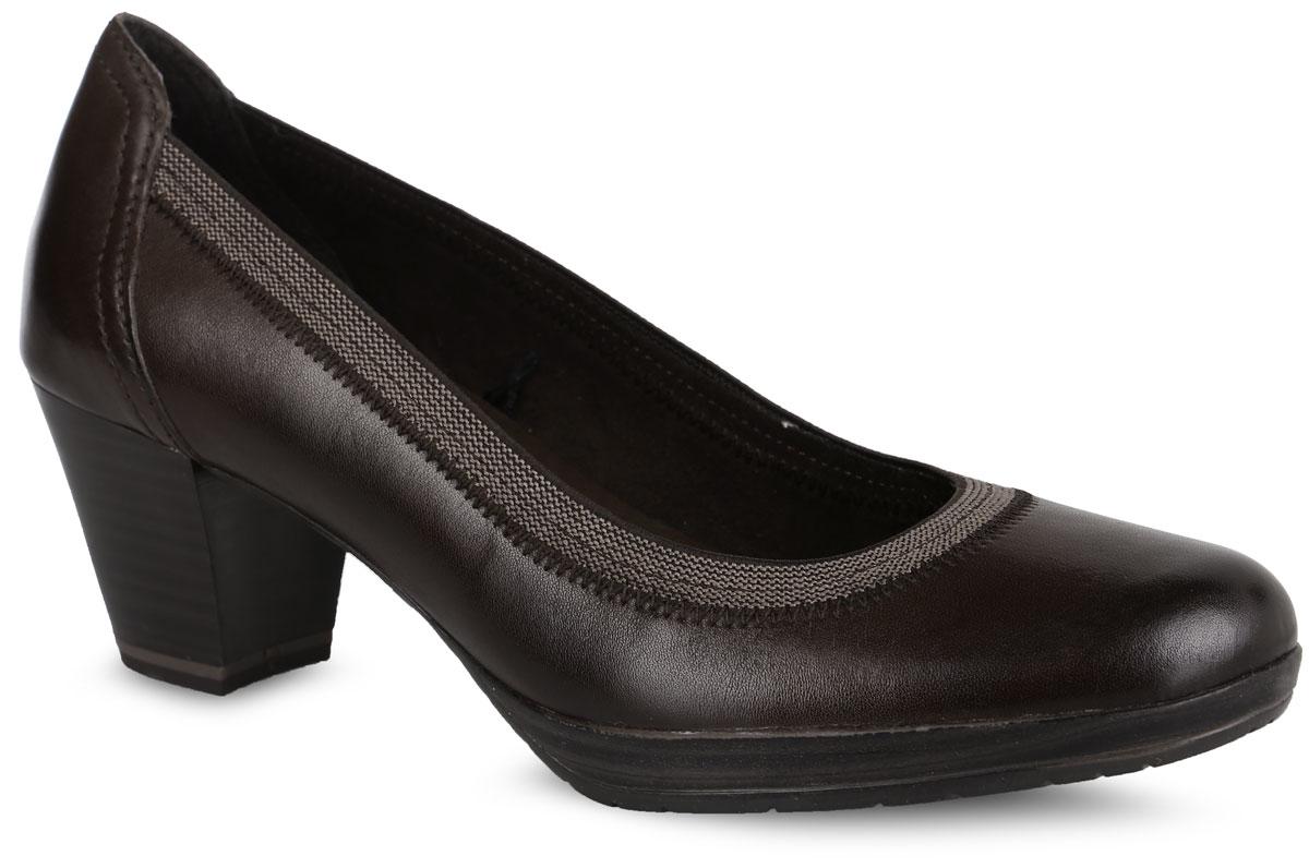 Туфли женские. 2-2-22418-27-3252-2-22418-27-325Стильные туфли от Marco Tozzi придутся вам по душе! Модель выполнена из натуральной кожи и дополнена эластичным кантом. Подкладка из текстиля не натирает. Мягкая стелька из материала ЭВА с поверхностью из искусственной кожи принимает форму стопы и обеспечивает этим максимальный комфорт. Каблук умеренной высоты оснащен амортизатором. Каблук и подошва с рифлением обеспечивают идеальное сцепление с любыми поверхностями. Элегантные туфли внесут изысканные нотки в ваш образ и подчеркнут вашу утонченную натуру.