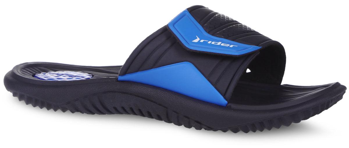 Шлепанцы мужские Everest AD FF. 81821-2399581821-23995Стильные мужские шлепанцы Everest AD FF от Rider не оставят вас равнодушным. Верх модели, выполненный из ПВХ, оформлен названием и логотипом бренда, сбоку - перфорацией, которая обеспечивает естественную вентиляцию и оснащен застежкой-липучкой, которая надежно зафиксирует изделие на ноге. Внутренняя поверхность из текстиля не натирает. Разработанная с учетом технологии Aerogel воздушно-гелиевая камера, расположенная в области пятки, смягчает шаг, в результате чего ноги меньше устают при движении. Протектор на подошве гарантируют отличное сцепление с любой поверхностью. Модные шлепанцы покорят вас своим дизайном и удобством!