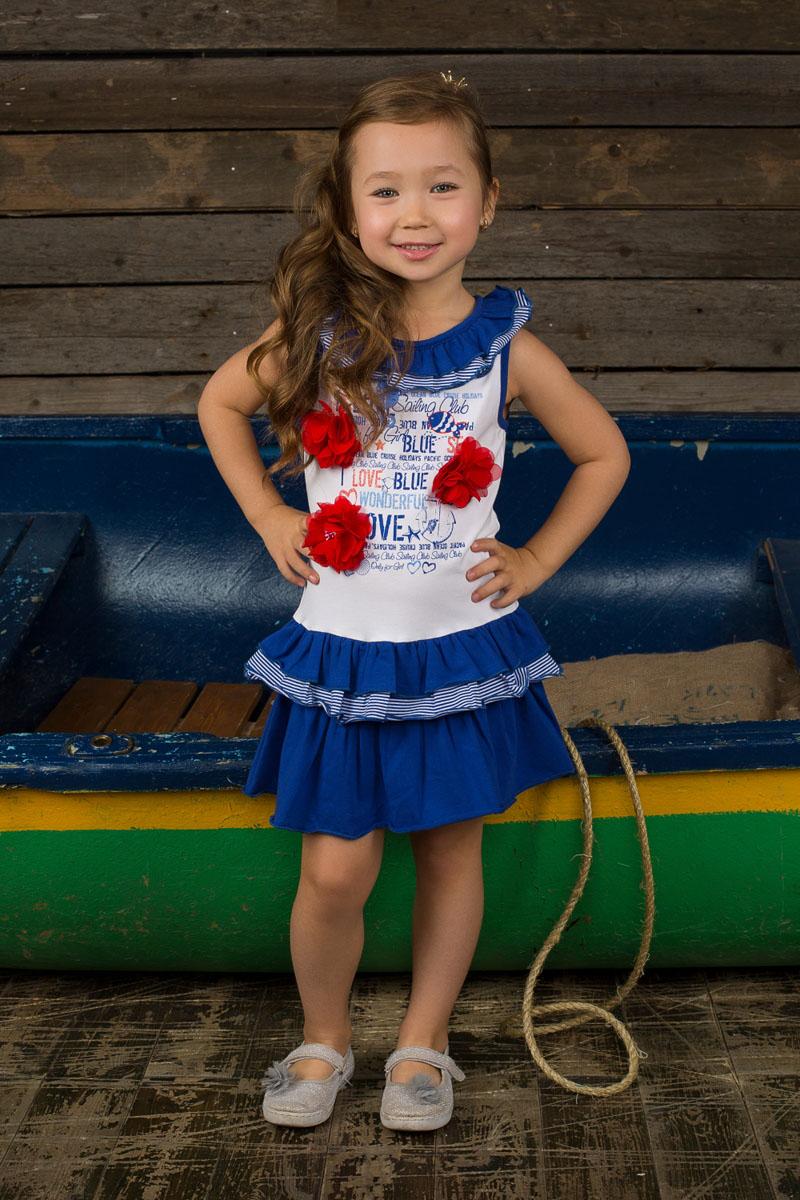 Платье для девочки. 195466195466Очаровательное платье для девочки Sweet Berry идеально подойдет вашей маленькой принцессе. Изготовленное из эластичного хлопка, оно необычайно мягкое и приятное на ощупь, не сковывает движения ребенка и позволяет коже дышать, не раздражает даже самую нежную и чувствительную кожу, обеспечивая наибольший комфорт. Платье с круглым вырезом горловины, на спинке застегивается на кнопки. Модель оформлена оригинальным принтом со стразами и объемными контрастными цветами. Горловина дополнена рюшей. Низ изделия оформлен тройной оборкой, которая придает платью пышность и легкость. Оригинальный современный дизайн и модная расцветка делают это платье модным и стильным предметом детского гардероба. В нем ваша модница будет чувствовать себя уютно и комфортно, и всегда будет в центре внимания!