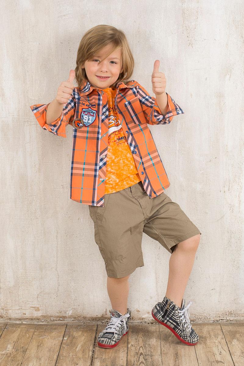 Рубашка для мальчика. 196317196317Стильная рубашка для мальчика Sweet Berry идеально подойдет вашему маленькому мужчине. Изготовленная из натурального хлопка, она мягкая и приятная на ощупь, не сковывает движения и позволяет коже дышать, обеспечивая наибольший комфорт. Рубашка с отложным воротником и длинными рукавами застегивается на кнопки по всей длине. Рукава понизу дополнены манжетами на застежках-кнопках. По бокам изделия предусмотрены небольшие разрезы. Спереди расположен накладной кармашек. Модель оформлена принтом в клетку, украшена нашивками и принтовой надписью. Дизайн и расцветка делают эту рубашку модным предметом детского гардероба. Она отлично сочетается как с джинсами, так и с классическими брюками.