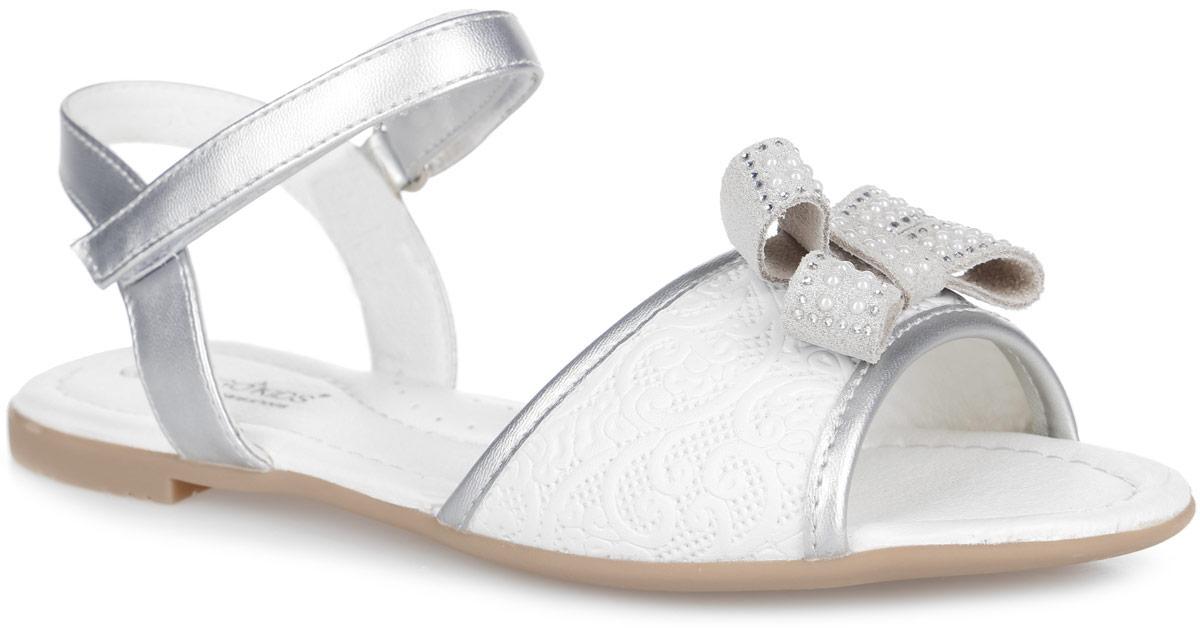 21-220A/12Модные сандалии от Indigo Kids придутся по душе вашей девочке и идеально подойдут для повседневной носки в летнюю погоду! Модель, выполненная из натуральной и искусственной кожи, оформлена на переднем ремешке декоративным тиснением и бантиком, украшенным стразами. Ремешок с застежкой-липучкой обеспечивает надежную фиксацию модели на ноге. Внутренняя поверхность и стелька из натуральной кожи комфортны при ходьбе. Стелька оснащена супинатором, который обеспечивает правильное положение стопы ребенка при ходьбе и предотвращает плоскостопие. Подошва с рифлением гарантирует отличное сцепление с любой поверхностью. Стильные сандалии - незаменимая вещь в гардеробе каждой девочки!