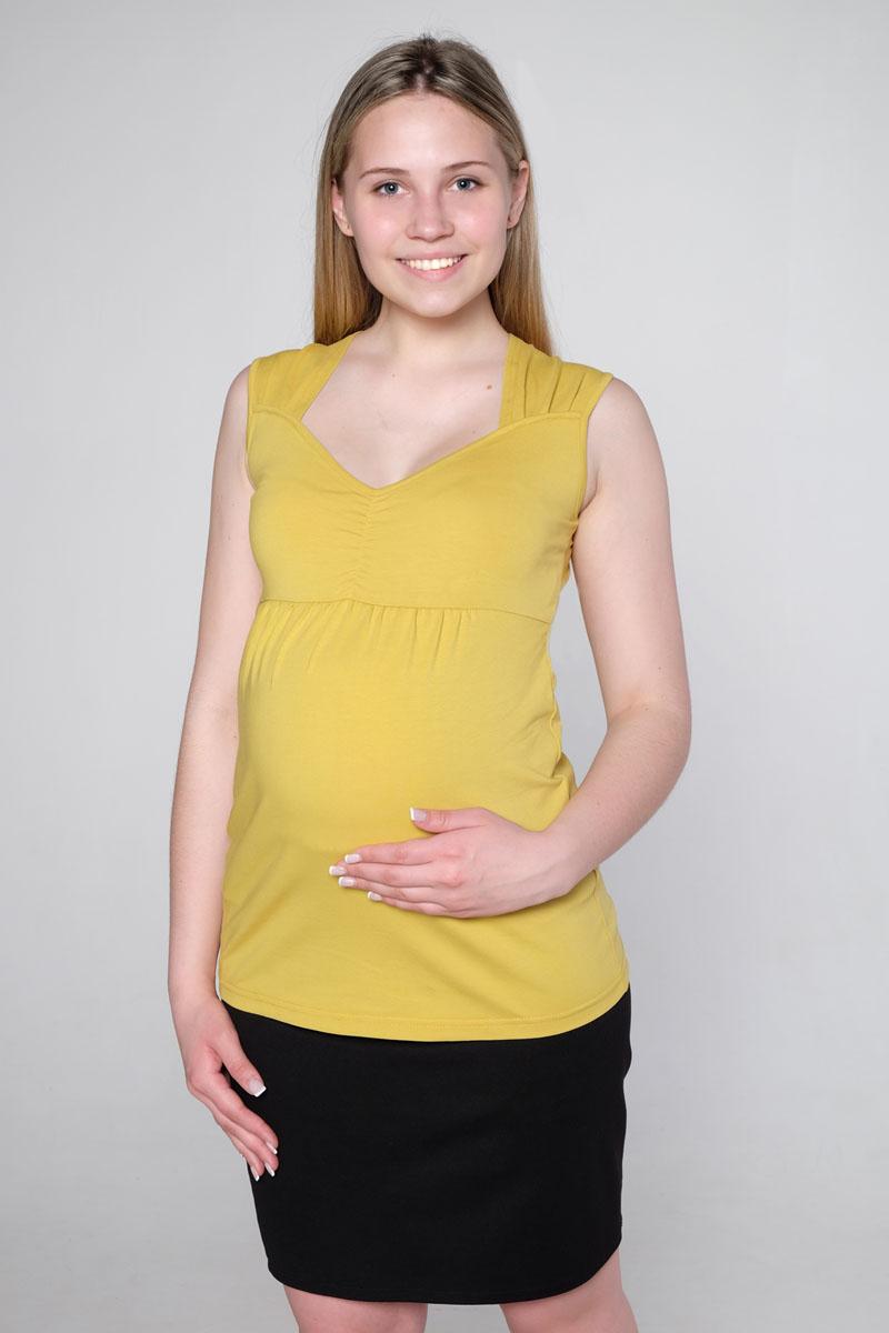 Блузка22902Блуза женская для беременных и кормящих выполнена из эластичного хлопка. Фигурный вырез горловины, полочка отрезная под грудью, со сборкой для животика.