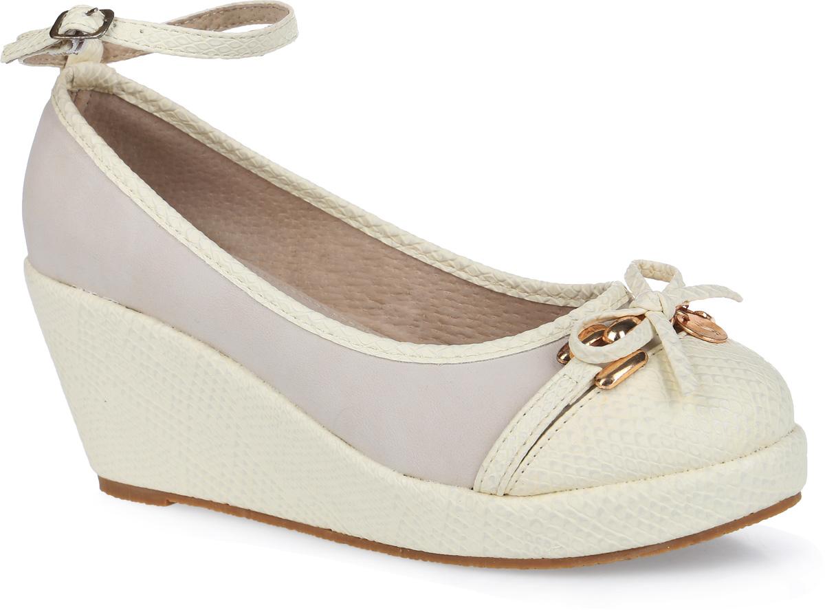 000340075Симпатичные модные туфли для девочки от торговой марки Аллигаша придутся по вкусу юным модницам. Модель выполнена из высококачественной искусственной кожи с тиснением под рептилию и искусственного нубука. Мыс украшен аккуратным бантиком и стильной фурнитурой. Подклад и стелька выполнены из натуральной кожи. Изящный съемный ремешок позволяет использовать данную модель, как с ним, так и без него. Туфли на танкетке и не большой платформе очень комфортны и удобны в носке. Эти туфли созданы для стильных юных модниц!