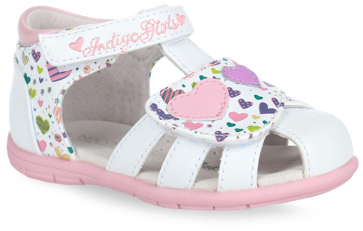 Сандалии для девочки. 20-21020-210A/12Прелестные сандалии от Indigo Kids придутся по душе вашей девочке и идеально подойдут для повседневной носки в летнюю погоду! Модель выполнена из искусственной кожи и оформлена принтом в виде сердечек, на переднем ремешке - нашивками в виде двух сердечек, на верхнем ремешке - вышитым названием бренда. Ремешки с застежками-липучками обеспечивают надежную фиксацию модели на ноге. Внутренняя поверхность и стелька из натуральной кожи комфортны при ходьбе. Стелька оснащена супинатором, который обеспечивает правильное положение стопы ребенка при ходьбе и предотвращает плоскостопие. Подошва с рифлением гарантирует отличное сцепление с любой поверхностью. Стильные сандалии - незаменимая вещь в гардеробе каждой девочки!