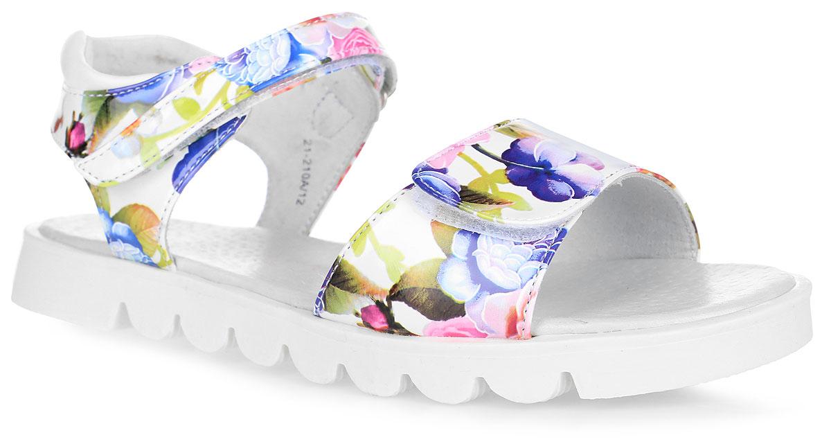Сандалии для девочки. 21-210A/1221-210A/12Прелестные сандалии от Indigo Kids придутся по душе вашей девочке и идеально подойдут для повседневной носки в летнюю погоду! Модель изготовлена из искусственной лакированной кожи и оформлена цветочным принтом. Ремешки с застежками-липучками обеспечивают надежную фиксацию модели на ноге. Внутренняя поверхность и стелька из натуральной кожи комфортны при ходьбе. Стелька оснащена супинатором, который обеспечивает правильное положение стопы ребенка при ходьбе и предотвращает плоскостопие. Гибкая подошва с рифлением гарантирует отличное сцепление с любой поверхностью. Стильные сандалии - незаменимая вещь в гардеробе каждой девочки!