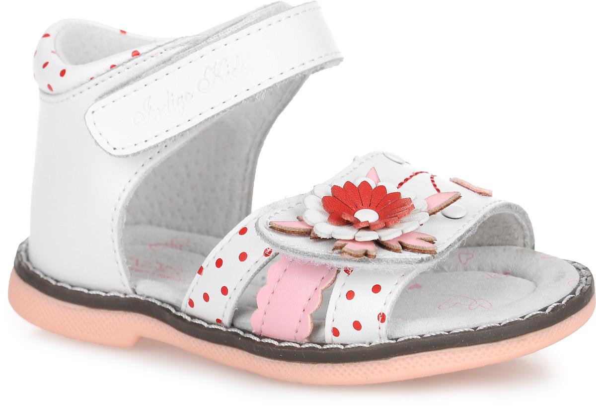 Сандалии для девочки. 21-16421-164A/12Прелестные сандалии от Indigo Kids придутся по душе вашей девочке и идеально подойдут для повседневной носки в летнюю погоду! Модель, выполненная из натуральной кожи, оформлена принтом в горох, на переднем ремешке - декоративным цветком, металлическими заклепками и декоративной прострочкой. Ремешки с застежками-липучками обеспечивают надежную фиксацию модели на ноге. Внутренняя поверхность и стелька из натуральной кожи комфортны при ходьбе. Стелька оснащена супинатором, который обеспечивает правильное положение стопы ребенка при ходьбе и предотвращает плоскостопие. Подошва с рифлением гарантирует отличное сцепление с любой поверхностью. Стильные сандалии - незаменимая вещь в гардеробе каждой девочки!