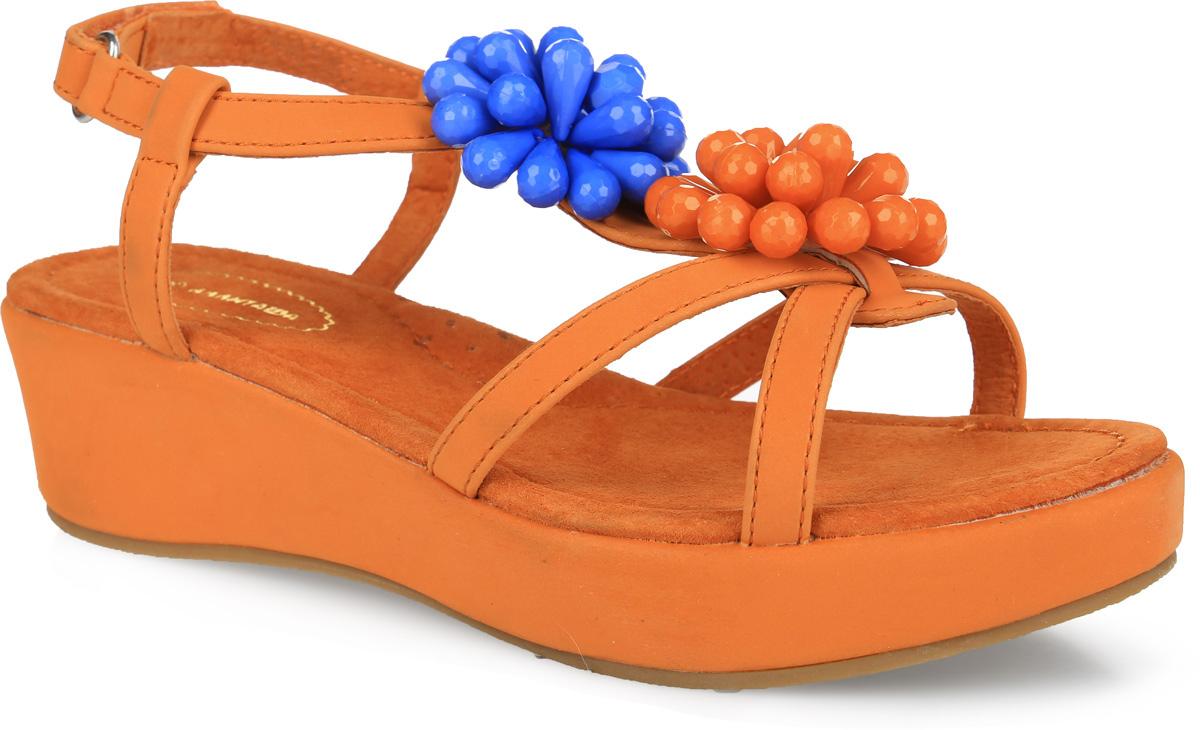 40Прелестные босоножки от Аллигаша придутся по душе вашей девочке и идеально подойдут для повседневной носки в летнюю погоду! Модель выполнена из искусственной кожи. Ремешок на подъеме оформлен композициями из пластиковых бусин. Ремешок с застежкой-липучкой обеспечивает надежную фиксацию модели на ноге. Внутренняя поверхность и стелька из натуральной кожи комфортны при ходьбе. Стелька дополнена супинатором с перфорацией, который обеспечивает правильное положение стопы ребенка при ходьбе и предотвращает плоскостопие. Танкетка компенсирована платформой. Подошва с рифлением гарантирует отличное сцепление с любой поверхностью. Модные босоножки - незаменимая вещь в гардеробе каждой девочки!