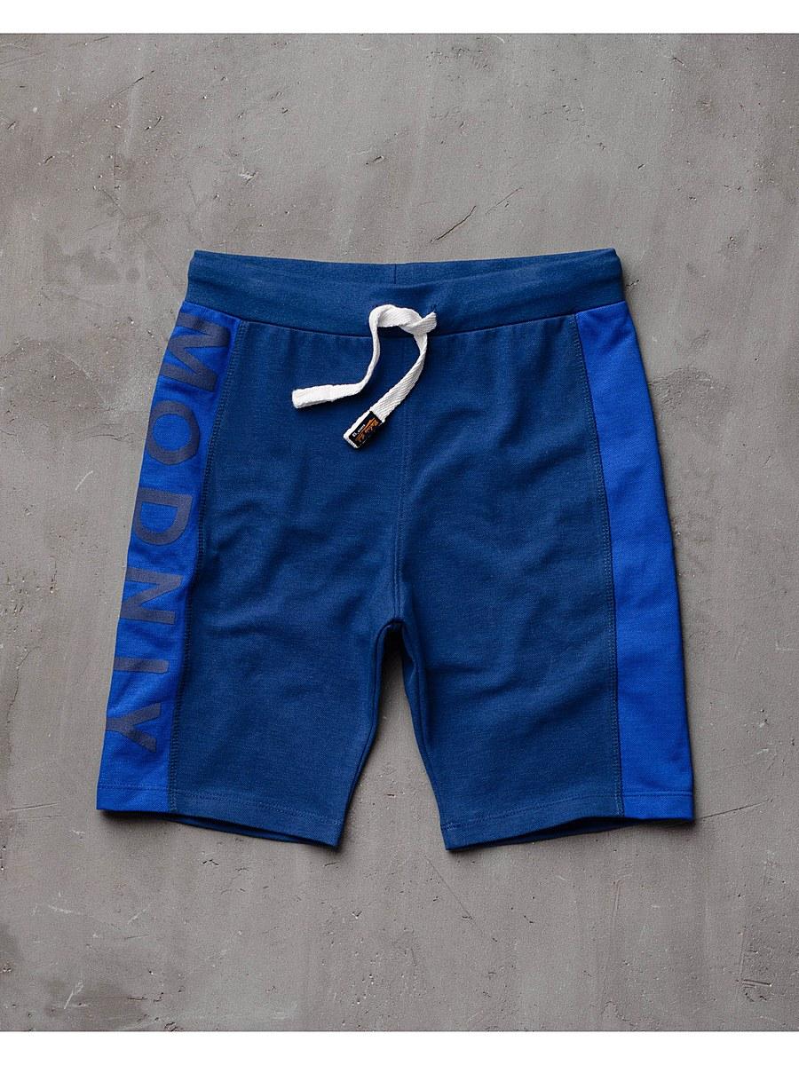 Шорты10В00070300Удобные шорты для мальчика Modniy Juk Modniy идеально подойдут вашему маленькому моднику. Изготовленные из хлопка и полиэстера, они не сковывают движения, обладают высокой износостойкостью, отводят влагу от тела и позволяют коже дышать, обеспечивая наибольший комфорт. Шорты полуприлегающего силуэта имеют широкую эластичную резинку на поясе, которая надежно фиксирует изделие и не сдавливает животик малыша. Объем талии регулируется при помощи шнурка-кулиски. Шорты оформлены крупным принтом с надписью Modniy по брючине. Практичные и стильные шорты идеально подойдут вашему малышу, а модная расцветка и высококачественный материал позволят ему комфортно чувствовать себя в течение дня и всегда оставаться в центре внимания!