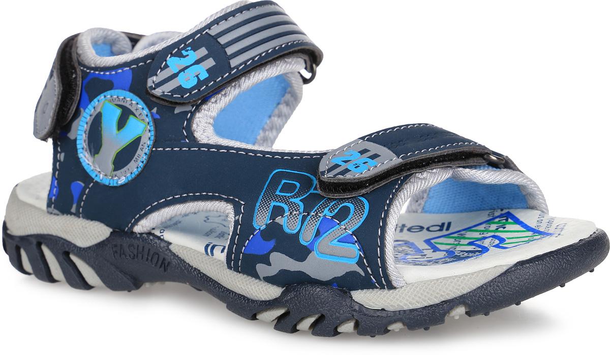 Сандалии для мальчика. 22-096A/1422-096A/14Стильные сандалии от Indigo Kids придутся по душе вашему малышу и идеально подойдут для повседневной носки в летнюю погоду! Модель, выполненная из искусственной кожи, оформлена символикой бренда и контрастными вставками. Ремешки с застежками-липучками прочно зафиксируют модель на ножке. Внутренняя поверхность выполнена из текстиля, благодаря чему дарит комфорт. Стелька оснащена супинатором с перфорацией, который обеспечивает правильное положение стопы ребенка при движении и предотвращает плоскостопие. Подошва с рифлением гарантирует отличное сцепление с любой поверхностью. Практичные сандалии - незаменимая вещь в гардеробе малыша!