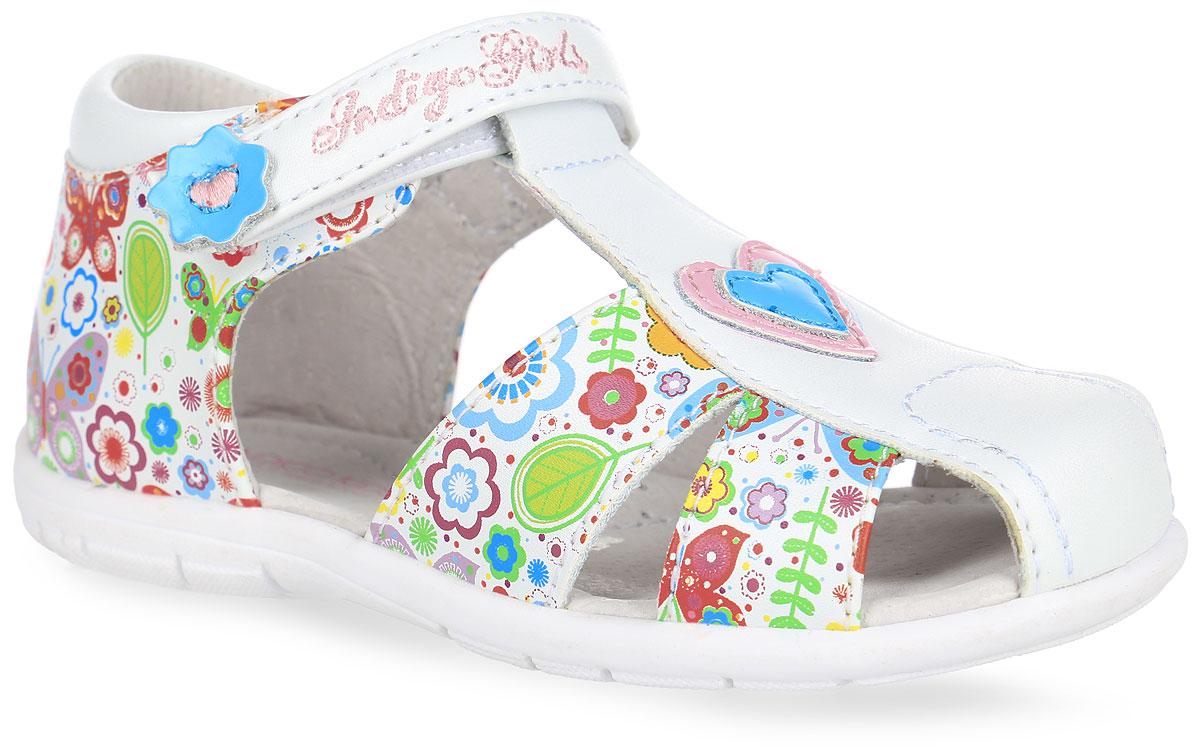 Сандалии для девочки. 20-212A/1220-212A/12Прелестные сандалии от Indigo Kids придутся по душе вашей девочке и идеально подойдут для повседневной носки в летнюю погоду! Модель, выполненная из искусственной и натуральной кожи, оформлена ярким принтом, спереди - декоративной нашивкой в виде сердца, на ремешке - декоративной нашивкой и вышитым названием бренда. Ремешок с застежкой-липучкой обеспечивает надежную фиксацию модели на ноге. Внутренняя поверхность и стелька из натуральной кожи комфортны при ходьбе. Стелька дополнена супинатором, который обеспечивает правильное положение стопы ребенка при ходьбе и предотвращает плоскостопие. Подошва с рифлением гарантирует отличное сцепление с любой поверхностью. Прелестные сандалии - незаменимая вещь в гардеробе каждой девочки!