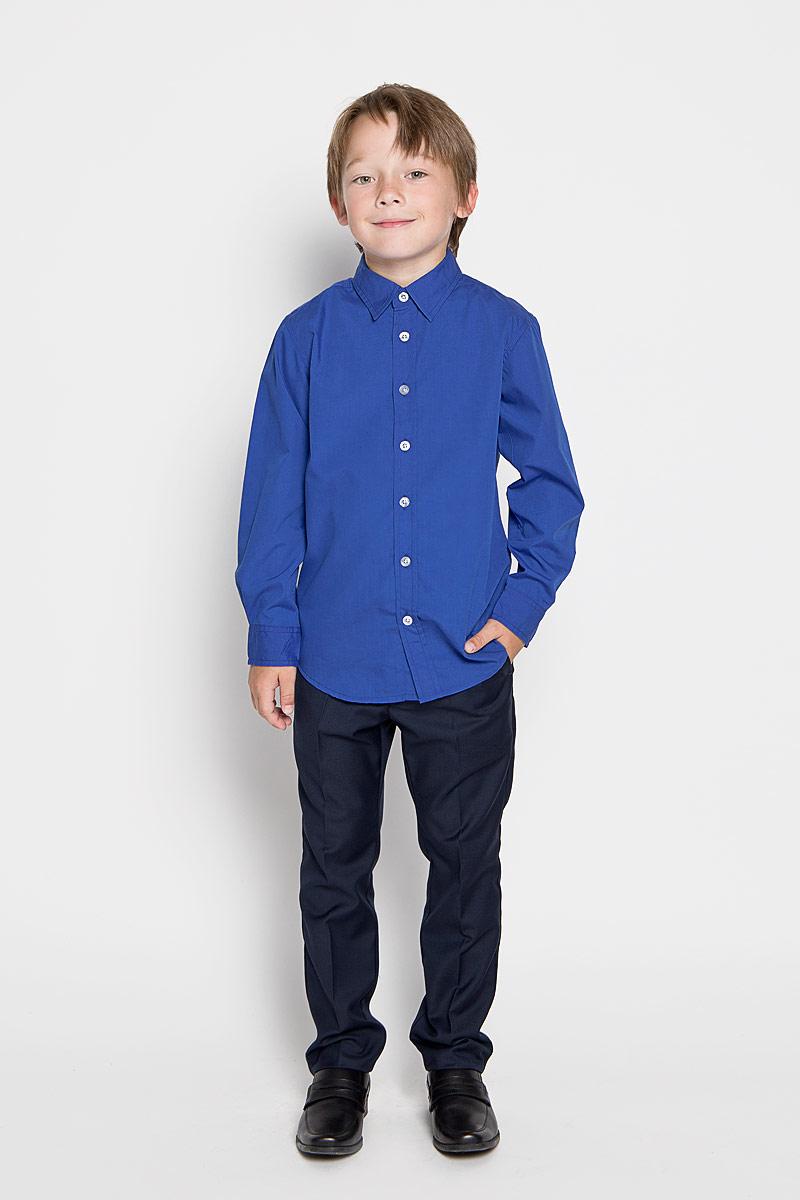 Рубашка для мальчика. H-812/185-6311H-812/185-6311Стильная рубашка для мальчика Sela идеально подойдет вашему ребенку. Изготовленная из полиэстера с добавлением хлопка, она мягкая и приятная на ощупь, обладает высокой износостойкостью, не сковывает движения и позволяет коже дышать, обеспечивая наибольший комфорт. Рубашка с длинными рукавами и отложным воротничком застегивается на пластиковые пуговицы по всей длине. Манжеты рукавов также застегиваются на пуговицы. Классическая однотонная рубашка будет превосходно сочетаться как с джинсами, так и с классическими брюками. Современный дизайн и расцветка делают эту рубашку стильным предметом детского гардероба.