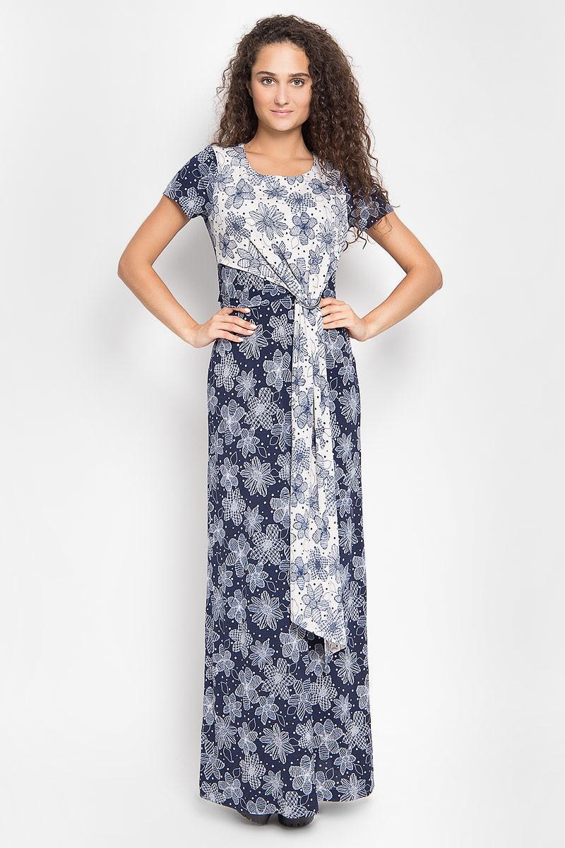 111100_22Платье-макси Ruxara, выполненное из высококачественного комбинированного материала, поможет создать отличный современный образ в стиле Casual. Модель с круглым вырезом горловины и короткими рукавами. Спереди изделие дополнено отлетной, ассиметричной кокеткой. Платье оформлено оригинальным цветочным принтом. Такое платье поможет создать яркий и привлекательный образ, в нем вам будет удобно и комфортно.