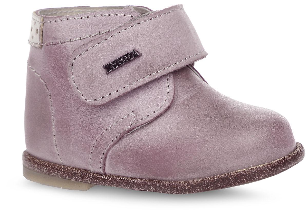 Ботинки для девочки. 10417-2010417-20Прелестные ботинки от Зебра придутся по душе вашей юной моднице! Модель, выполненная из натуральной высококачественной кожи, оформлена декоративной прострочкой. Ремешок на застежке-липучке, оформленный логотипом бренда, надежно зафиксирует изделие на ножке ребенка. Стелька из ЭВА материала с верхним покрытием из натуральной кожи дополнена супинатором с перфорацией, который обеспечивает правильное положение ноги ребенка при ходьбе. Рельефная поверхность на подошве и на каблуке гарантирует отличное сцепление с любой поверхностью. Ортопедический каблук укрепляет подошву под средней частью стопы и препятствует ее заваливанию внутрь. Стильные ботинки поднимут настроение вам и вашему ребенку!