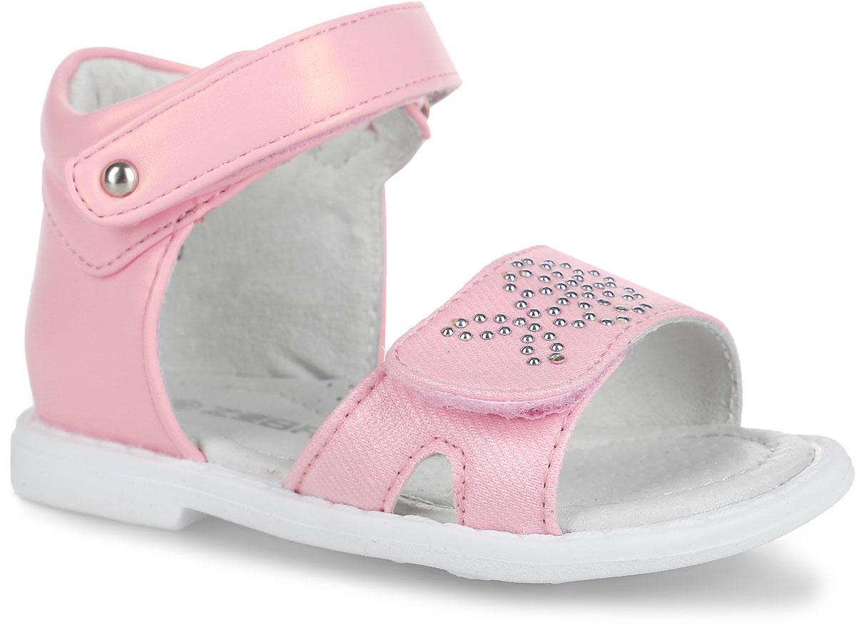 Сандалии для девочки. 10384-910384-9Чудесные сандалии от Зебра придутся по душе вашей девочке. Модель выполнена из искусственной кожи. Стелька дополнена небольшим супинатором, который обеспечивает правильное положение ноги ребенка при ходьбе, предотвращает плоскостопие. Полужесткий закрытый задник и ремешки с застежками-липучками прочно закрепят модель на ножке. Верхний ремешок оформлен декоративной кнопкой, нижний - металлическими полубусинами. Подошва выполнена из гибкого, не скользящего материала, устойчивого к истиранию и перепадам температур. Практичные и стильные сандалии займут достойное место в гардеробе вашей малышки.