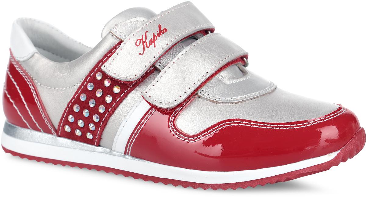 Кроссовки для девочки. 22342-122342-1Прелестные кроссовки от Kapika придутся по душе вашей девочке. Модель, выполненная из натуральной и искусственной кожи, оформлена прострочкой, стразами и на ремешке надписью с названием бренда. Ремешки с застежками-липучками обеспечат надежную фиксацию модели на ноге. Подкладка и стелька из натуральной кожи обеспечивают комфорт и предотвращают натирание. Стелька дополнена супинатором с перфорацией, который обеспечивает максимальную устойчивость ноги при ходьбе, правильное формирование стопы и снижение общей утомляемости ног. Подошва с рифлением гарантирует идеальное сцепление с любой поверхностью. Стильные кроссовки - незаменимая вещь в гардеробе каждой девочки!
