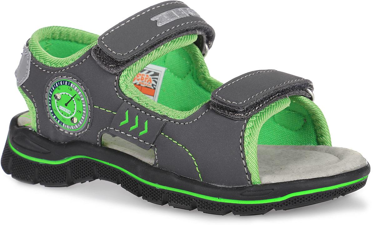 Сандалии для мальчика. 10333-1010333-10Модные сандалии от Зебра не оставят равнодушным вашего мальчика! Модель изготовлена из искусственной кожи и текстиля, оформлена прострочкой и декоративной нашивкой в виде спидометра, на которой при ходьбе мигают огоньки. Ремешки на застежках-липучках, один из которых украшен названием бренда, прочно зафиксируют обувь на ножке. Внутренняя поверхность изделия выполнена из мягкого текстиля. Стелька с поверхностью из натуральной кожи дополнена супинатором, который обеспечивает правильное положение ноги ребенка при ходьбе и предотвращает плоскостопие. Рельефный протектор подошвы гарантирует отличное сцепление с любыми поверхностями. Практичные и стильные сандалии займут достойное место в гардеробе вашего ребенка.