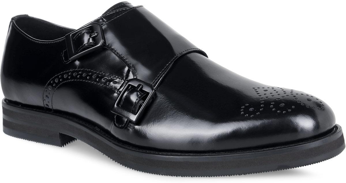 M23618Трендовые мужские туфли Vitacci займут достойное место в вашем гардеробе. Модель изготовлена из высококачественной натуральной кожи и оформлена на мыске перфорированным узором. Ремешок с металлическими пряжками, расположенный на подъеме, обеспечивает оптимальную посадку обуви. Стелька из натуральной кожи позволяет ногам дышать. Каблук и подошва с протектором обеспечивают идеальное сцепление с поверхностью. Стильные туфли не оставят равнодушным ни одного мужчину.